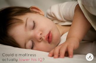beautiful baby boy sleeping on a mattress