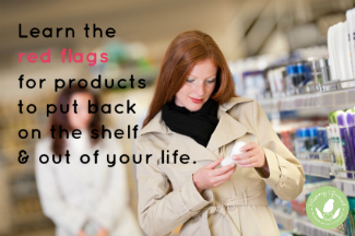 red-haired model in drugstore aisle looking at a label
