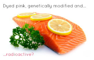 raw salmon with lemon slices and parsley
