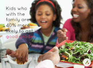 african american family enjoying salad and other healthy meal items