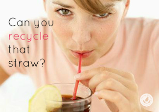 Girl drinking soda through a red straw