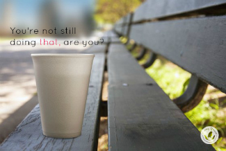 styrofoam cup on park bench