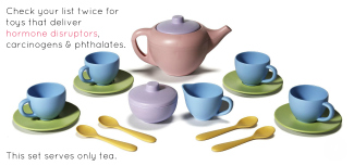 pastel colored toy tea set on white background