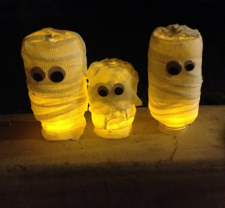 mummy jars with lights inside in the dark