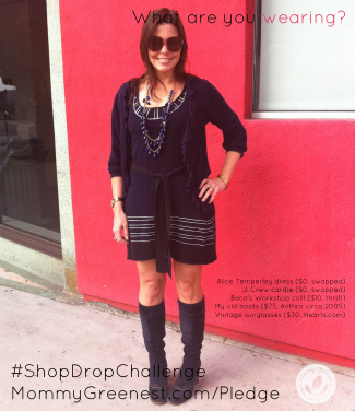 brunette wearing blue minidress and boots against red wall