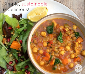 vegetable stew with salad greens and pomegranate seeds