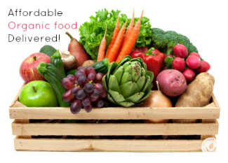 beautiful organic fruits and vegetables in a wood crate