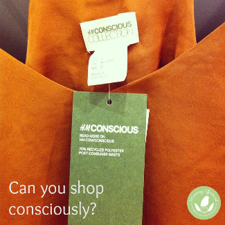 orange shirt with green H&M Conscious Collection tag showing 70% recycled polyester