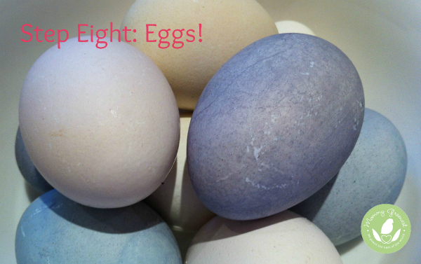 purple, blue, yellow and light pink easter eggs against white background