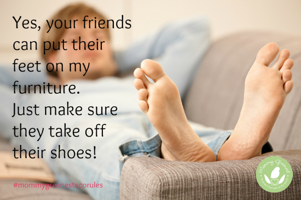 teenaged boy wearing jeans with bare feet up on couch