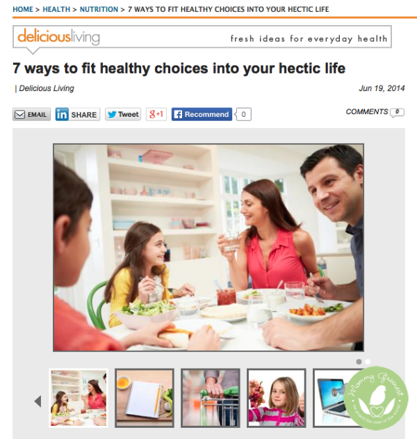 Photo of family sitting at a table in news story quoting Mommy Greenest on Delicious Living