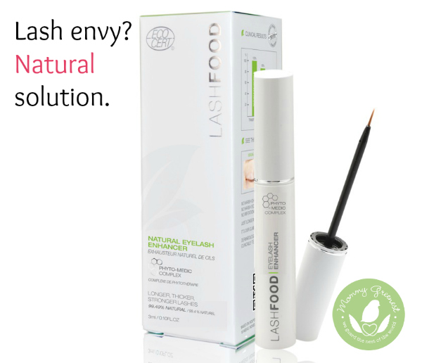 lash enhancer product in white tube next to white box against white background.