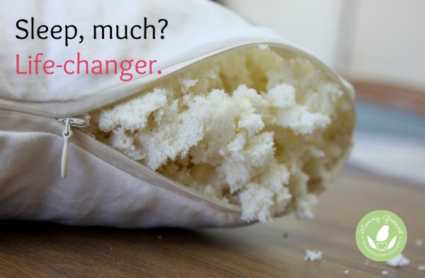 white pillow unzipped to show natural organic latex stuffing