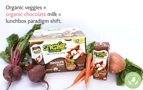 raw carrots and beets surround packaged organic healthy chocolate milk drinks
