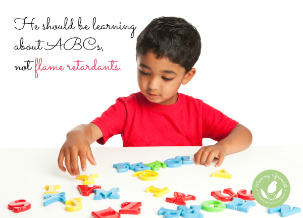 boy playing with alphabet letters on white table