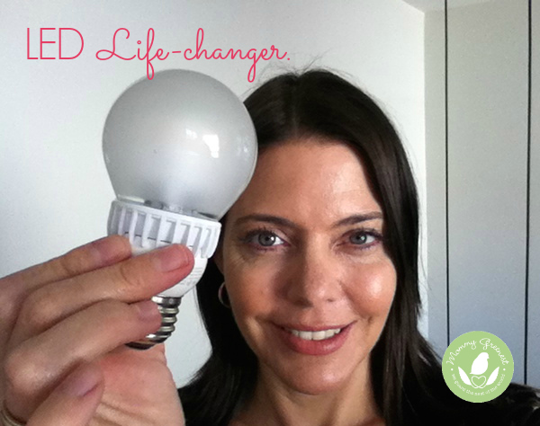 woman holds LED lightbulb