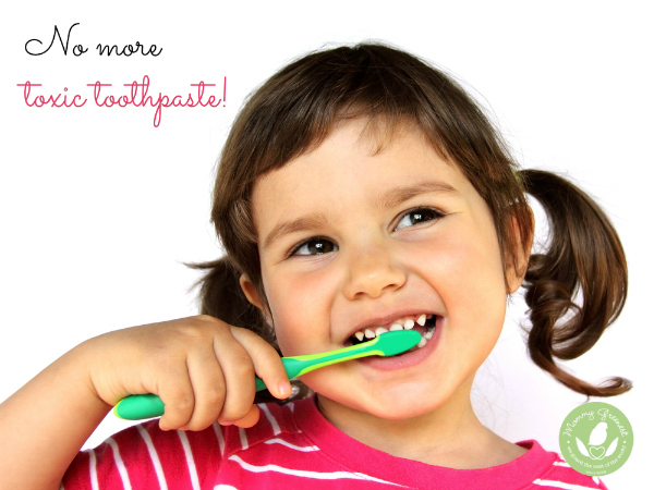 girl brushing teeth with kids toothpaste