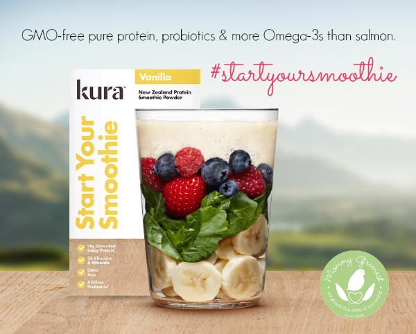 kura smoothie powder behind glass full of fruits and vegetables