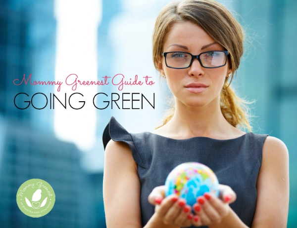 woman wearing glasses, holding toy globe in her hands