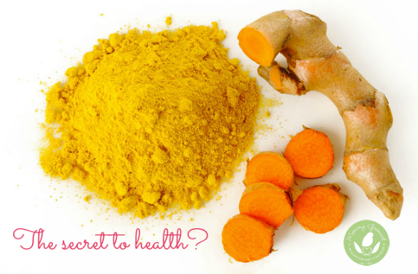 turmeric root and powder against white backdrop